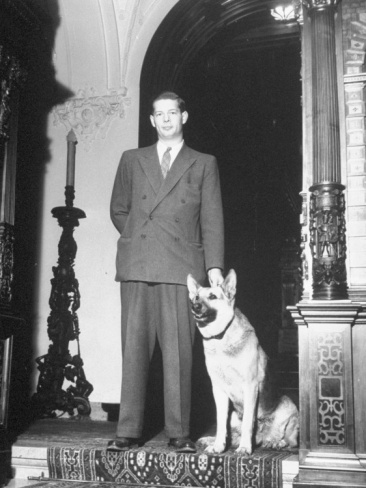 King Michael of Rumania Standing in Main Building of His Sinaia Palace with His Dog