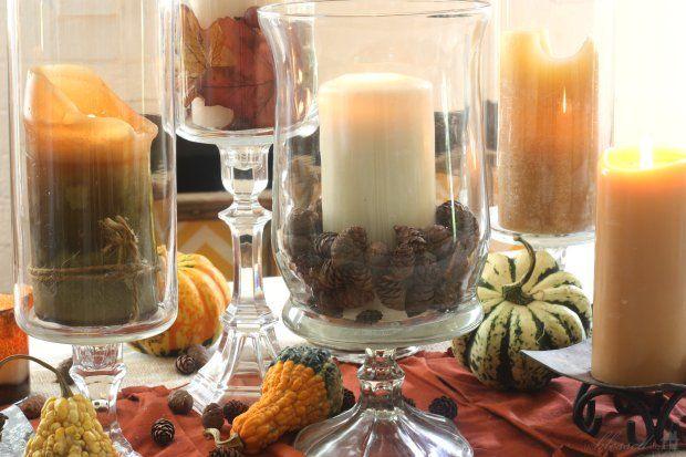 Szyszki w wazonie lub wokół świec to doskonałe uzupełnienie jesiennej aranżacji stołu.
