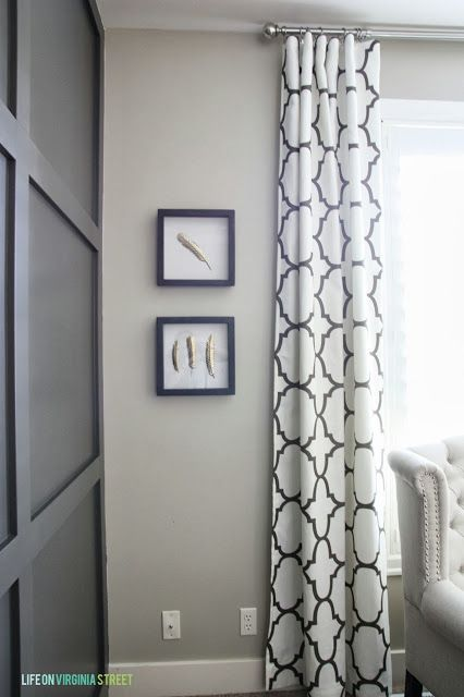 I think I'll drape my curtains from the ceiling.  I've always loved this idea.  The black/white is a crisp look.