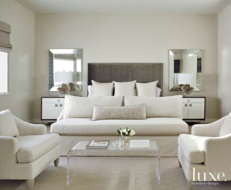 Barbara Barry for Baker chairs from Meredith O'Donnell take center stage in the master bedroom with a supporting cast that includes a custom sofa and a vintage coffee table from Area. Antique French mirrors from Uptowner Antiques in New Orleans add sparkle, while twin nightstands custom-designed by Chandos Interiors bestow sleekness.