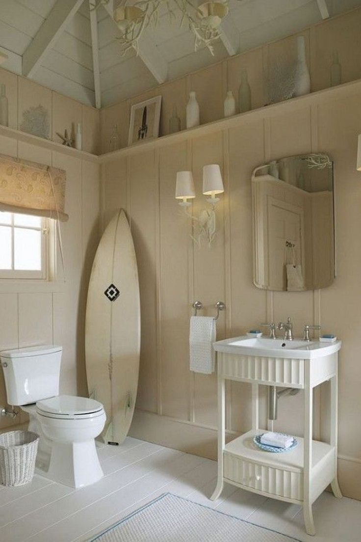 This is a big,cool Bathroom for a Beach House.It would be so easy to keep clean w/ tile floors.The vintage touches are charming & lots of girls or boys could fit into this bathroom.