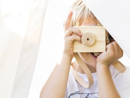 Give the special little one in your life the gift of photography with this wooden toy camera hand crafted from natural pine timber and finished with an aged leather neck strap. Child safe parts allowing you to relax during playtime.   Your little adventurer can wear this around their neck wherever t...