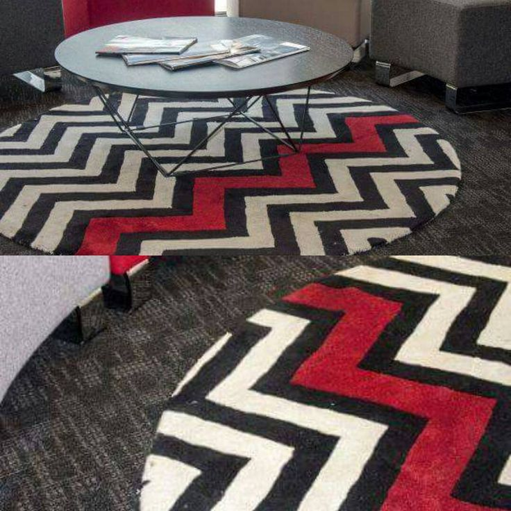 Diversity and style - We custom shaped one of our Macaulay rugs for a clients commercial job. The red pops against the monochrome design. #Macaulay #geometric #geometricpattern #roundrug #rugdesign #sourcemondialNZ