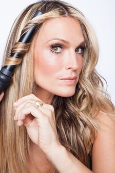 Section the hair into one-inch pieces and curl hair forward and backward: http://www.stylemepretty.com/living/2015/01/09/beachy-bombshell-hair-with-molly-sims-her-new-book/
