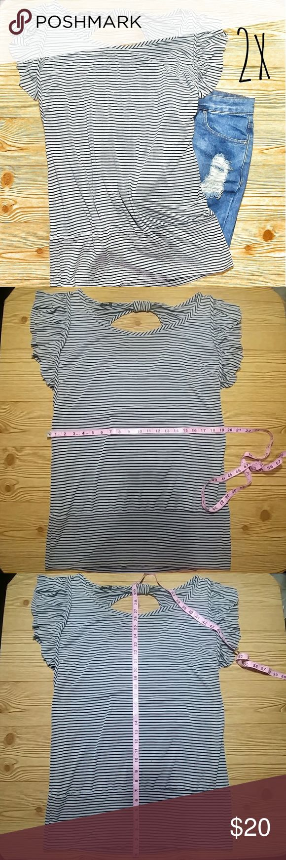 Vanity Black Gray Stripe Flowy Tee(2×) Like new great condition Offeres welcome, please ask any questions you may have. May qualify for discount shipping with offers. Cant read size on tag, but im guessing its a least a 2x. Very stretchy. Soft material. Open back area. Ruffles on shoulders. SHORTS ARE FOR SALE IN DIFFERENT LISTING. Vanity Tops