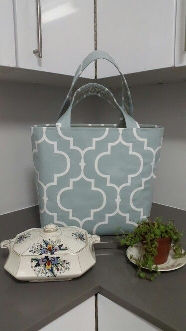 Pale Blue geometric patterned bag with inside pocket and zip closure