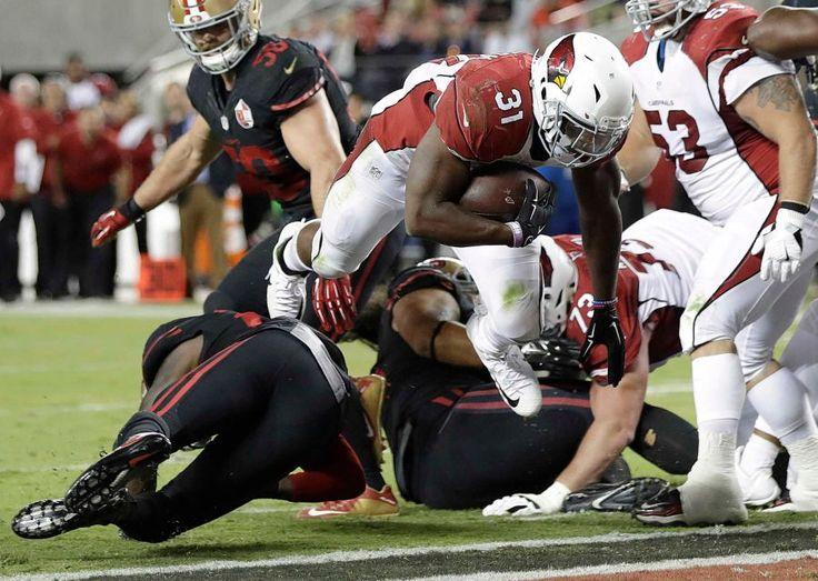 Thursday Night Football: Cardinals vs. 49ers  -  October 6, 2016:  33 - 21, Cardinals  -    Arizona Cardinals running back David Johnson (31) scores a touchdown against the San Francisco 49ers during the second half of an NFL football game in Santa Clara, Calif., Thursday, Oct. 6, 2016.