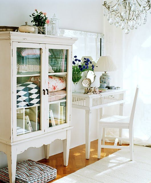 I love the old quilts displayed in the cabinet.  I love the glass doors.  I love…