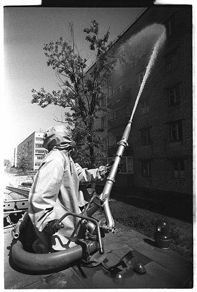 """May 1986: After the evacuation of Chernobyl on 5 May, 1986, liquidators wash the radioactive dust off the streets using a product called """"bourda"""", meaning molasses. Chernobyl had about 15,000 inhabitants before the accident.  Photograph: Igor Kostin/Corbis"""