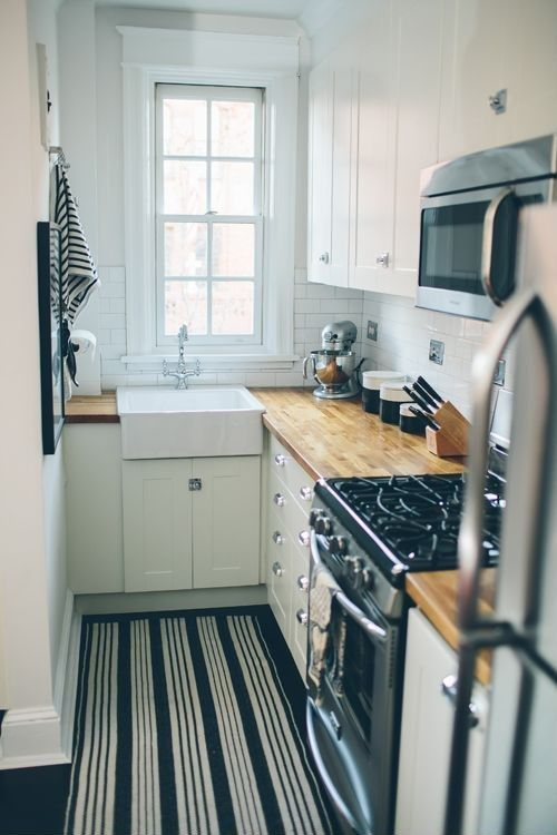 Cottage Kitchen with Flat panel cabinets, Flush, Paint, Carpet, Surya Country Living Farmhouse Pinstripe Rug, Subway Tile