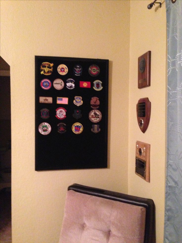 diy Military patch display. cheap thrift store corkboard, spray adhesive, rubber cement (for the corners)- or a staple gun...wide piece of the soft/loop side of hook/loop material bought at hookandloop.com, and box cutter to cut neat edges. the loop material was $34 shipped but I found it to be worth it for a custom gift. -aschnabel84