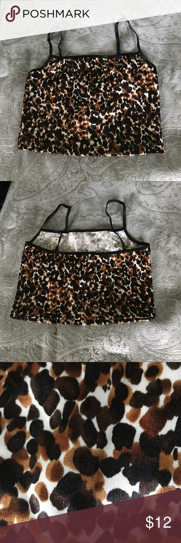 Leopard crop tank🐯🤗 Leopard crop tank .. very nice material.. not alot of stretch.  Tag says small, but I wold put this as an XS! Never worn or tried on! NWOT American Apparel Tops Crop Tops