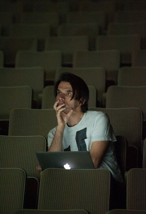 """Jonny Greenwood watches the rehearsals of """"There Will Be Blood"""" performed as part of David Byrne's Meltdown at the Royal Festival Hall on August 19, 2015 in London, England"""