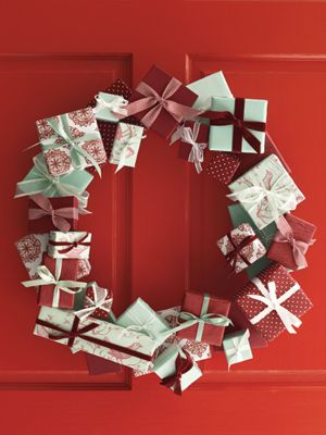 Small gift boxes make a beautiful and welcoming Christmas wreath as well as being inexpensive and who doesn't love to save money!!!