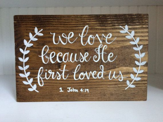 Hand-painted wooden calligraphy sign // 1 John 4:19 // We Love Because He First Loved Us // bible verse  L = 10.5in W = 7 in H = 3/4 in