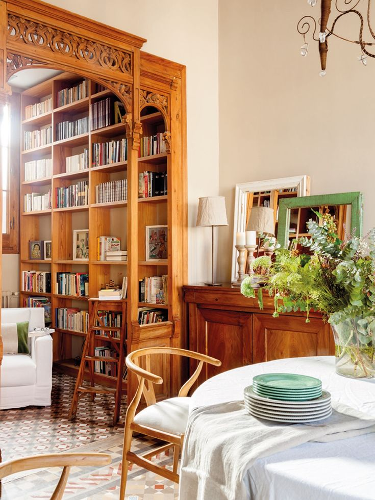 Beautiful Barcelona flat packed with wooden furniture and details - modernist-style framework