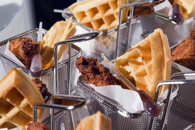 Baskets of fried chicken, waffles, and syrup dispensers at Baccanal Buffet Las Vegas......how did I miss the syrup dispenser!!! BAR NONE.....the best buffet I've ever been to!!