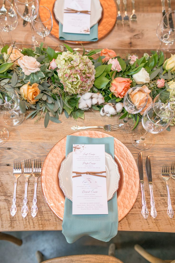 table setting // table decor // reception dinner // wedding reception // rehearsal dinner // wedding inspiration // hydrangea // roses // pastel palette // pink and yellow // greenery // teal napkins // copper // farm tables