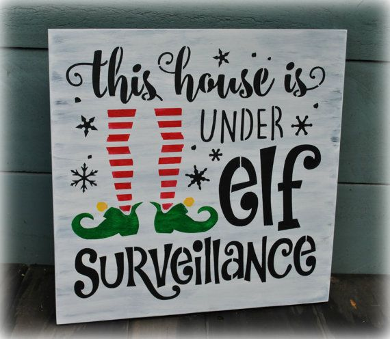 This is an approx. 12 x 12 wood sign. It reads: This house is under elf Surveillance. All signs are hand painted or stained, sealed and