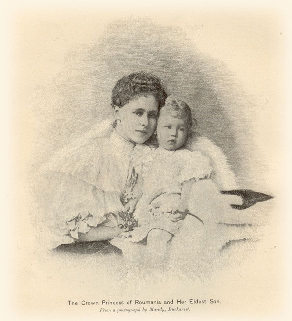 Queen Marie of Romania and her son Carol.