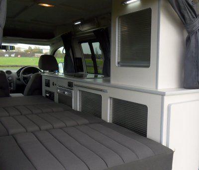 bed in a small camper van