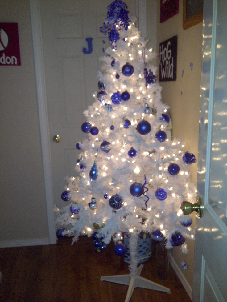 white christmas tree with royal blue decorations | Holiday