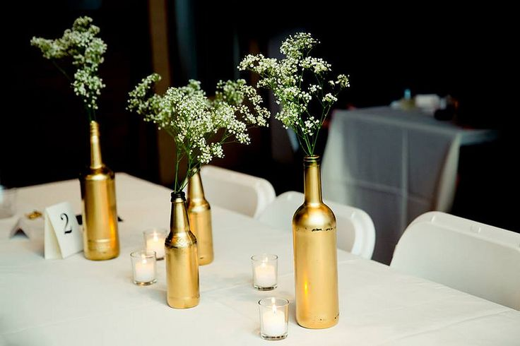 17 best images about centerpieces tablescapes and escort for Gold wine bottle centerpieces