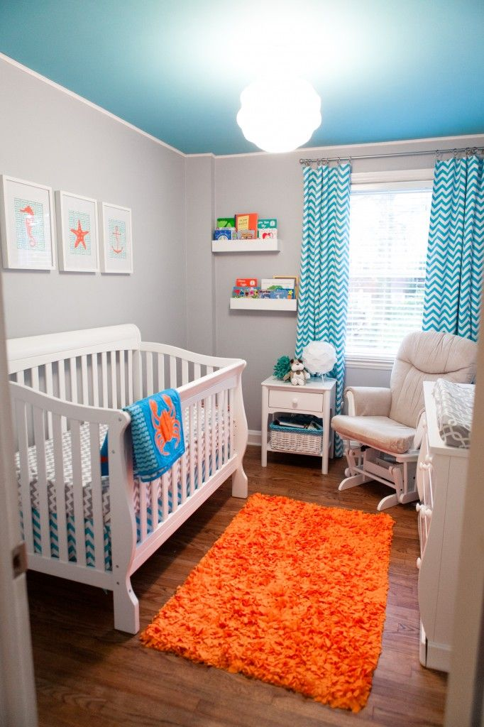 Turquoise, Grey and Orange--LOVE the color of the ceiling, it perfectly offsets the walls; also love the beach theme, though I could do without the curtains. -- this could be for any other small room..love it.
