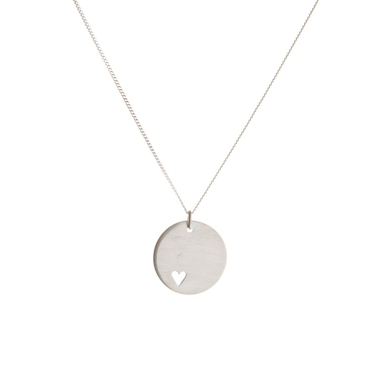 pendant prettiness   A sterling silver disc, with a small heart shape cut out, on a silver chain.