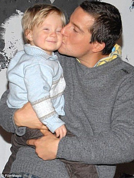 The amazingly sexy Bear Grylls with his son, Jesse.  Melt <3