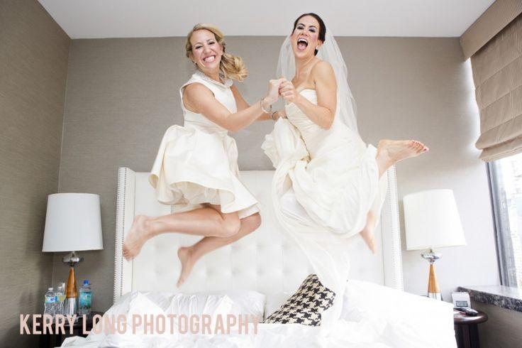 Bride and Maid of Honor Jumping on the Bed - Fun Wedding photo idea. NYC Wedding www.kerrylong.com