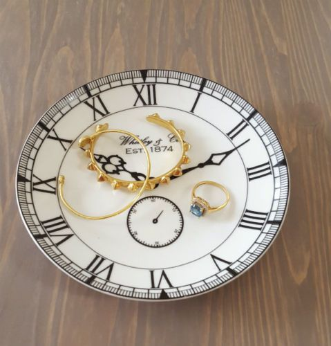 Vintage-Inspired dish decorated with a pretty clock face in black. I use mine as a Trinket Tray for Jewelry.