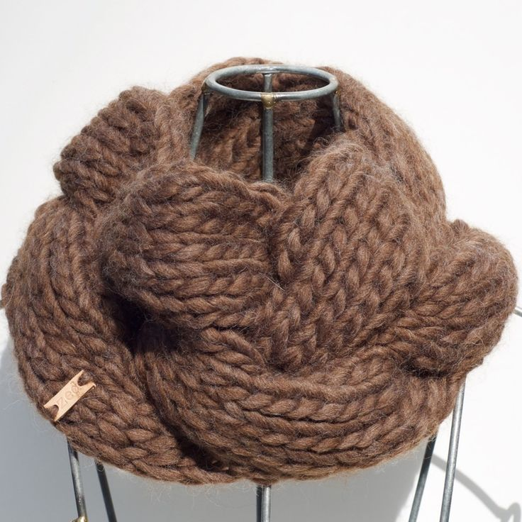 Emme is a hand-knit cabled cowl in mocha-coloured Peruvian highland wool