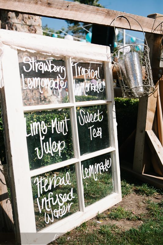 Window panes used as signage at food or drink stations during a wedding reception