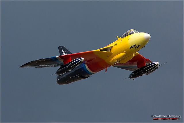 """Hawker Hunter F-58A """"Miss Demeanour"""" G-PSST performs in front of stormy skies at Lowestoft Air Festival in Suffolk"""