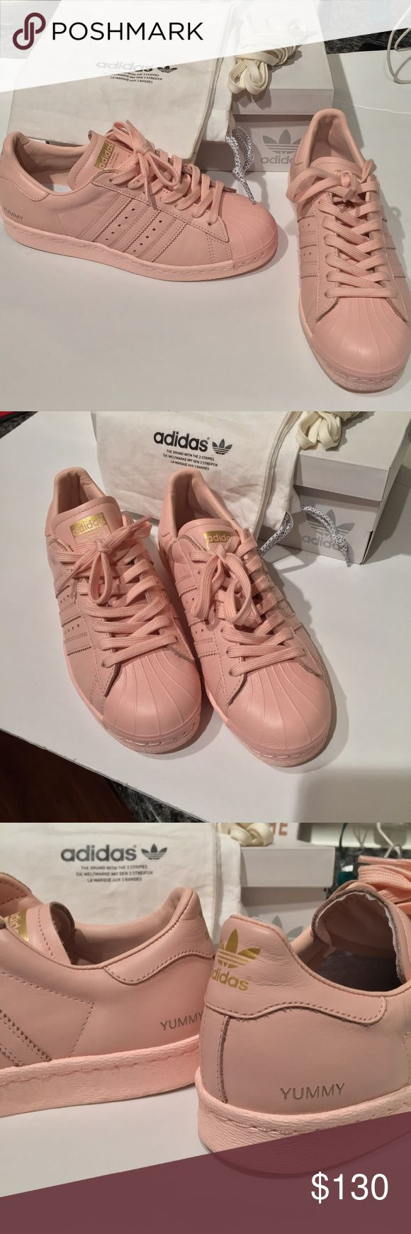 """Pastel pink adidas superstar Pastel pink adidas with gold! """"Yummy"""" on each side. Only Worn once. Includes original box, dust bag and extra laces (cream) there is some creasing on the right shoe :( ❤️️NO TRADES❤️️ Adidas Shoes Sneakers"""