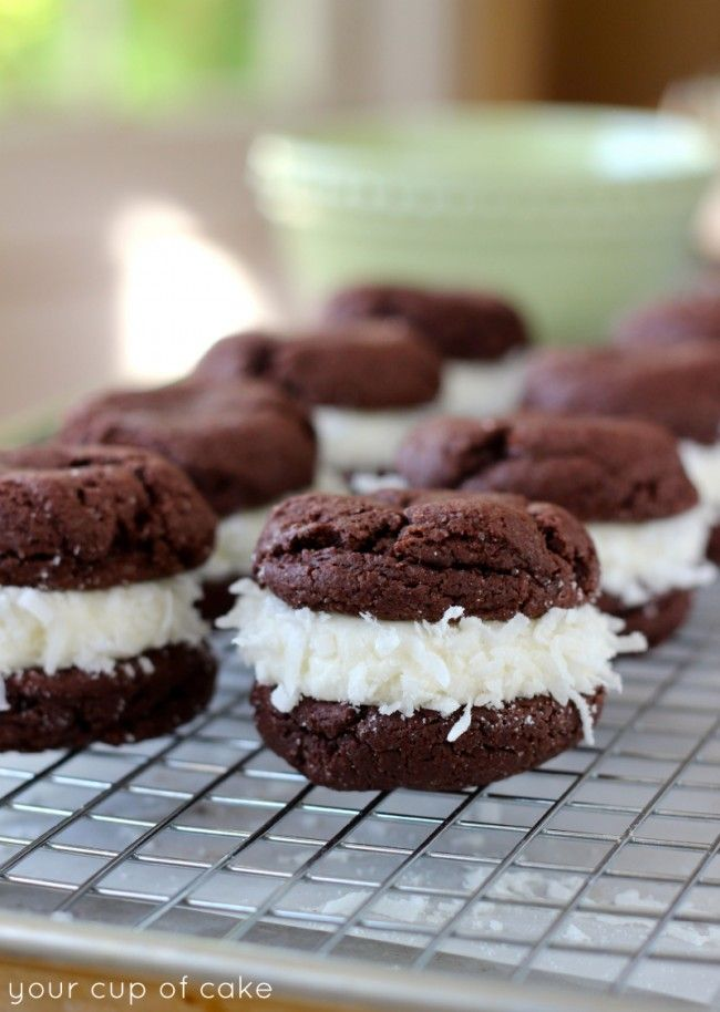 Chocolate Coconut Whoopie Pies at http://therecipecritic.com Delicious chocolate cookies made with a cake mix and a coconut cream center!