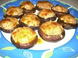 Stuffed Mushrooms 8 large fresh mushrooms1 tablespoon olive oil2 cups ricotta cheese3/4 cup grated Parmesan cheese3/4 cup shredded mozzarella cheese4 tablespoons pesto