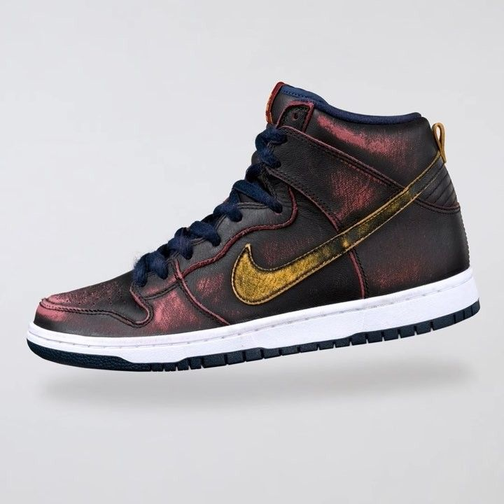 Nike Sb Dunk High Pro Nba With Its Painted Black Upper The Sb Nba Dunk High Wears Away Revealing Maroon And Gold Nike Skateboarding Sneakers Sneakers Men