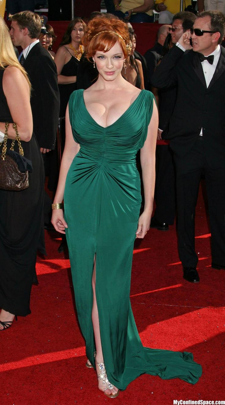 Christina Hendricks flaunts her curves on the red carpet in this stunning emerald number!