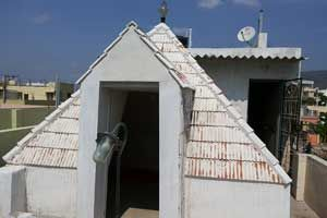 Sri Sadananda Yogi Pyramid Meditation Center,year of construction : 2008 size : 10ft x 10ft (roof top) | capacity : 15 persons cost incurred :  30,000 | type of structure : RCC timing : 6AM-8PM, open for public use  technical support : S V Vijaya Krishna  contact : S V Vijaya Krishna, +91 99080 42285  address : 8-68/1A1, 4th street, Sri nagar, Satya Narayanapuram, Tirupati. http://www.pyramidseverywhere.org/pyramids-directory/pyramids-in-andhra-pradesh/rayalaseema/chittoor-district