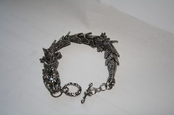 Ridged Back Dragon Bracelet #dragon #jewelry #pretty #silver #statement #steampunk #summer  40% off orders over $50.  Free shipping and handling orders of $25 or more.  #Christmas #Present  www.ceesquared.ca