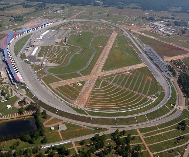 Who knows the story of why there is a runway in the infield at Talladega Superspeedway?