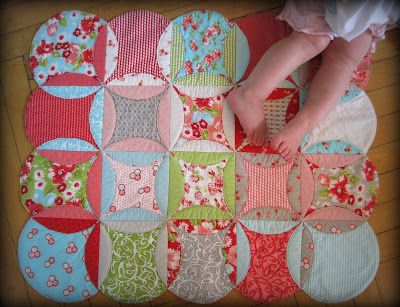 Moda Bake Shop: Cathedral Window Baby Playmat  Tweak this using an off-set square. less wasted fabric than cutting circles