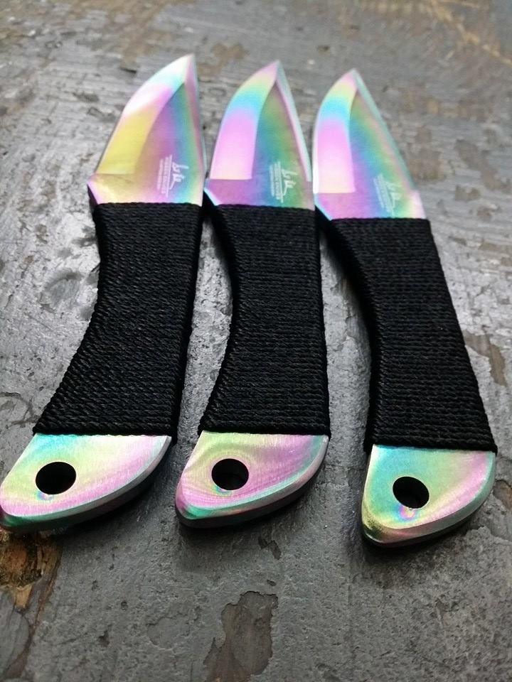 "Master knife maker and throwing knife legend Gil Hibben has updated his most popular throwing knife design, this time with an anodized titanium rainbow finish. Each razor-sharp thrower is one solid piece of thick stainless steel with a cord wrapped handle, and each throwing knife measures 8 ½"" overall. House the entire set in the nylon belt sheath."