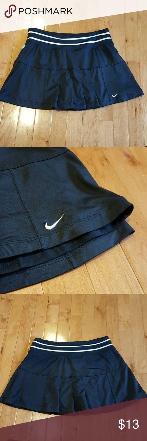 Nike Tennis Skort Navy blue Dri-fit Nike tennis skort. Perfect condition, never worn! Nike Shorts Skorts