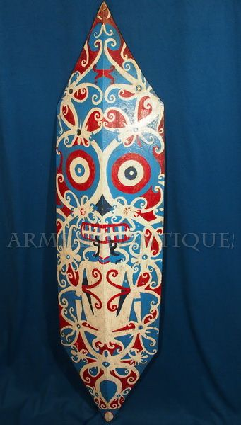 """An uncommon early-mid 20th C. Iban Dayak Borneo carved and painted shield. Overall is 42"""" long and 12"""" wide."""