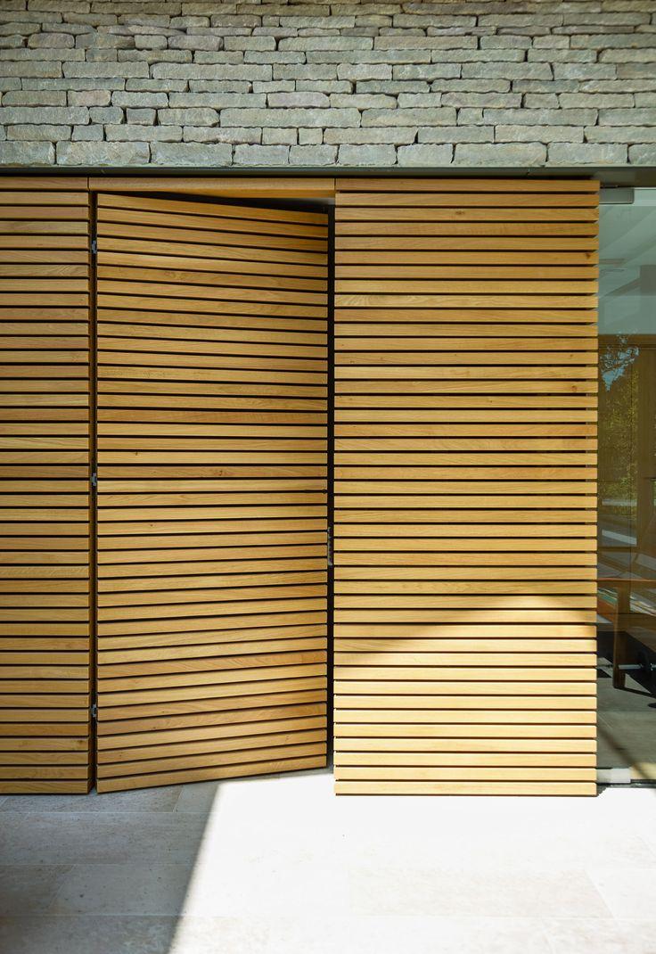 Hidden bathroom door - Contemporary New Pool House Detail Hidden Door With Timber Slats And Stone Detailing