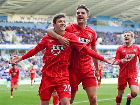 Adam Lallana celebrating his goal with Jay Rodriguez