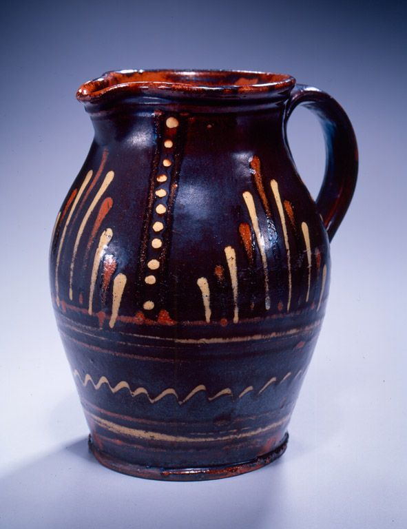 Rudolph Christ (1750-1833) - Moravian Pitcher. Slip Decorated Glazed Earthenware. Salem, North Carolina. Circa 1790-1800.